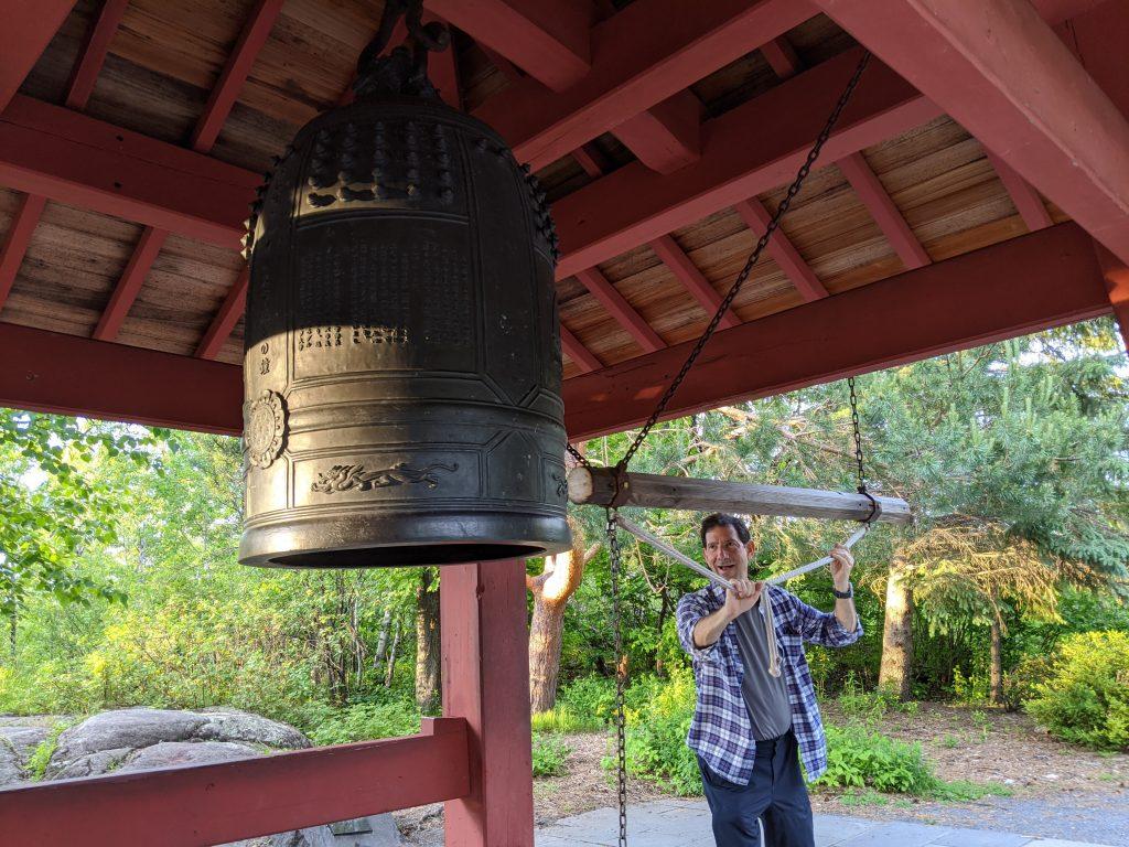 man ringing gong