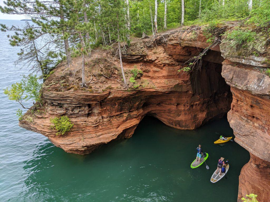 kayakers at sea caves