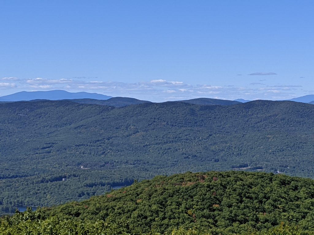 summit view of green mountains