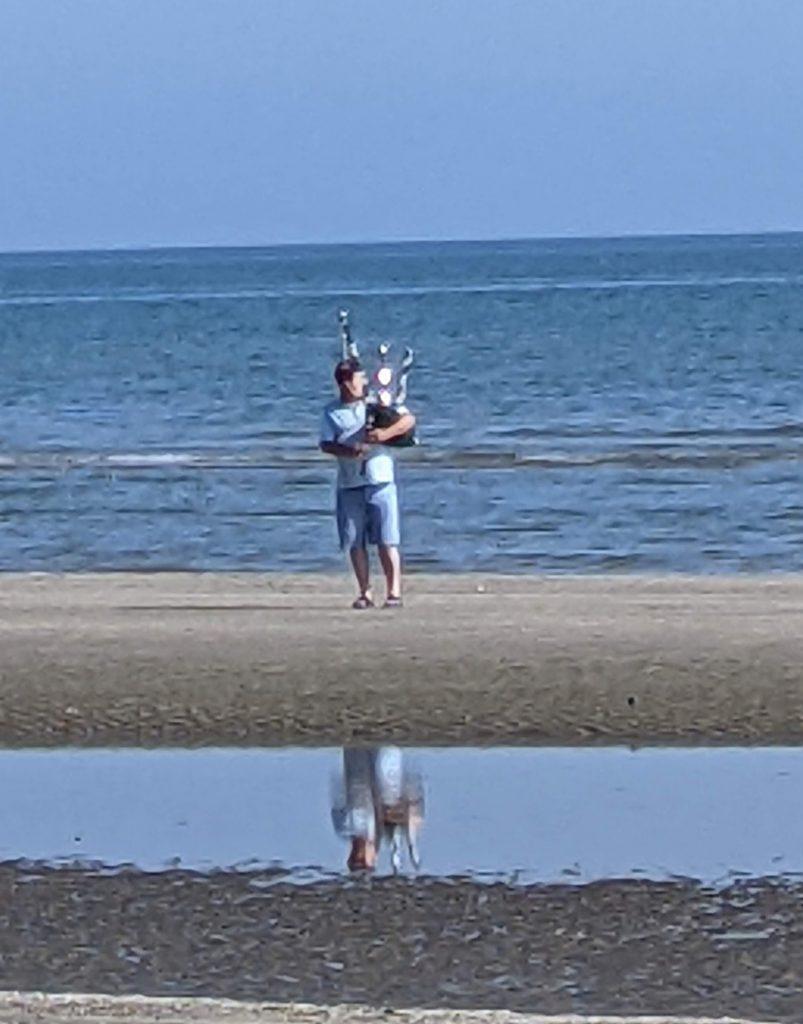 bagpiper on seashore